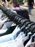 Choice. Variety shirts hang on the rack. Close up Royalty Free Stock Photos