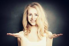 Choice. Woman chooses. Beautiful Girl Fashion Model Keeps Things Royalty Free Stock Photography