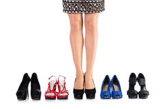 Choice of woman shoes. On white Royalty Free Stock Photo