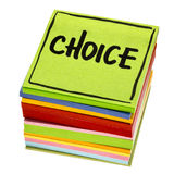 Choice word on reminder note. Choice word - handwriting in black ink on isolated stack of sticky notes Royalty Free Stock Photo