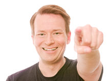 The choice is yours. Young smiling man pointing at you, for choosing and decision concepts - isolated on white and retouched Stock Photography