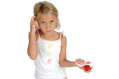 Choices. A child has to choose between eating a cookie or a strawberry fruit. Teaching children about healthier diets. Child on white background isolated. Child Royalty Free Stock Photo