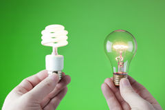 Choices. Making a choice between incandescent and fluorescent light source Royalty Free Stock Photography