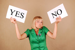 Choices. Young woman with a Yes/No signs Stock Photography