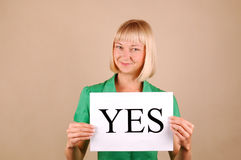 Choices. Young woman with a Yes/No signs Royalty Free Stock Image