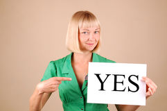Choices. Young woman with a Yes/No signs Royalty Free Stock Photography