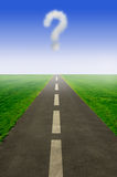 Choices ahead. Question mark cloud hovering above an open road Stock Photo