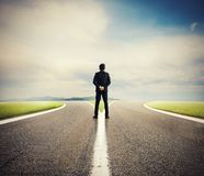 Choices of a businessman at a crossroads. Concept of decision Stock Images