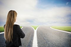 Choices of a businesswoman at a crossroads. Concept of decision royalty free stock photo