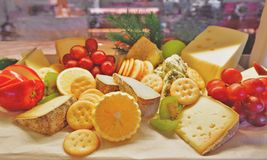 Choices of cheese variety with fruits and biscuits Stock Photo