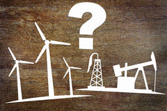Choices between clean renewable energy and oil production Royalty Free Stock Photos