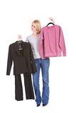 Choices: Woman Deciding Between Fancy Suit Or Lazy Sweatshirt Stock Photography