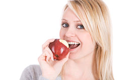 Choices: Woman Taking A Bite Of Apple Royalty Free Stock Photo