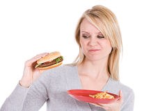 Choices: Woman Unsure Of Eating Burger Stock Image