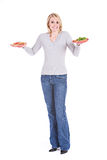 Choices: Woman Unsure Of What Food To Eat Stock Photography