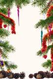 Choinek gałąź dekorowali z kolorową ornamentu tła ramą zdjęcia royalty free