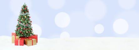 Choinki tła sztandaru śnieżne bławe złote piłki de Obraz Royalty Free