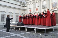 Choir concert. The Choir of Singing Society from Saska Kepa sing during the concert in the court of the Warsaw Royal Castle Artur Backiel conducts the choir Stock Image
