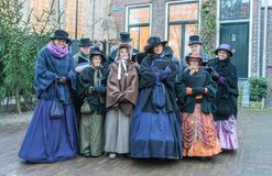 Choir of dressed actors singing inside the Dickens festival royalty free stock photos