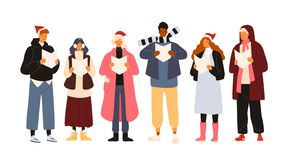Choir or group of cute men and woman dressed in outerwear singing Christmas carol, song or hymn. Smiling street singers