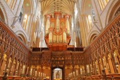 The choir inside the Cathedral with vaults, columns and wooden carvings royalty free stock photo