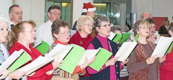 Choir singing Christmas carols. An image of members of Inverness Choral Society singing Christmas carols in aid of Charities on 17 th December 2011 stock images