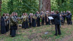 Choir singing in the forest Royalty Free Stock Image