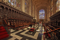 Choir Stalls Kings College Chapel. This view of the interior of Kings college chapel in Cambridge England, shows the choir stalls and above can be seen part of Stock Image
