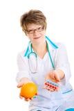 Choise between fruit of medcine Stock Photo