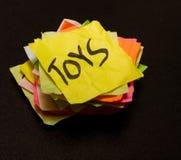 Choix de durée - argent de dépense sur des jouets Photographie stock libre de droits