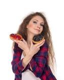 Choix difficile entre deux gâteaux Photographie stock libre de droits