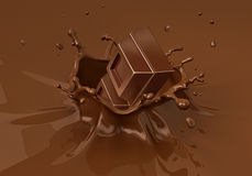 Chok blocks falling into liquid chocolate splashing. Close up view Royalty Free Stock Photo