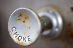 Choke Knob. A steampunk style retro choke knob - shallow depth of field stock photography