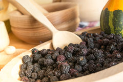 Chokeberry in wooden plate Royalty Free Stock Photos