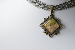 Choker-necklace with a pendant made of epoxy resin and maple leaves Stock Photography
