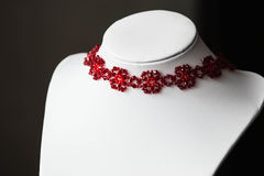 Choker necklace in the shape of flowers in red. Close up stock images