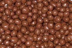Choklad - bestrukna russin Arkivfoton