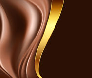 Choklad- och guldbakgrund Royaltyfria Foton