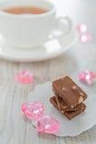 Choklad och tea Arkivfoto
