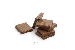 choklad söta högg av isolerade stycken Royaltyfri Fotografi