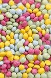 Chokladbönor i olika färger Fotografering för Bildbyråer