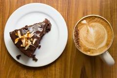 Chokladcake och kopp av kaffe Fotografering för Bildbyråer