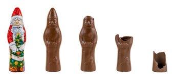 Chokladdiagram av Santa Claus som ätas Arkivbild