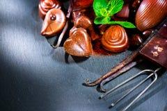 choklader Bränd mandelchokladsötsaker Arkivbild