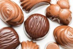 Choklader med olika former Fotografering för Bildbyråer