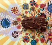 Chokladglass på papper med härliga modeller royaltyfria foton