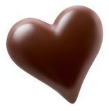 Chokladhjärta som isoleras på en vit bakgrund arkivbilder