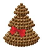 Chokladjulgran med det röda satängbandet arkivfoto