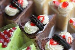 Chokladkaka och kaka Arkivfoton