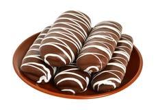 Chokladkexar på den bruna plattan Fotografering för Bildbyråer
